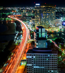 Fototapeta Mosty Fukuoka, Japan. Cityscape, Landscape, long exposure shot at night of the city of Fukuoka and its buildings and skyscrapers in the urban of Hakata in the island of Kyushu, Japan.