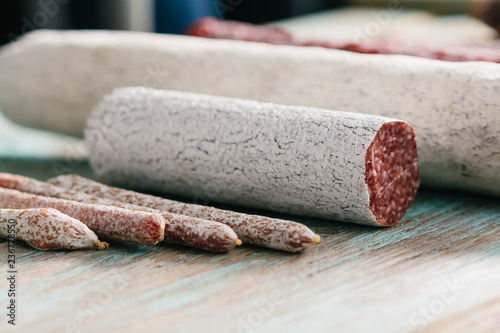 Valokuva  Various sausages on wooden table