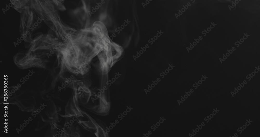 Fototapety, obrazy: closeup vapor stream rises from bottom center on black background