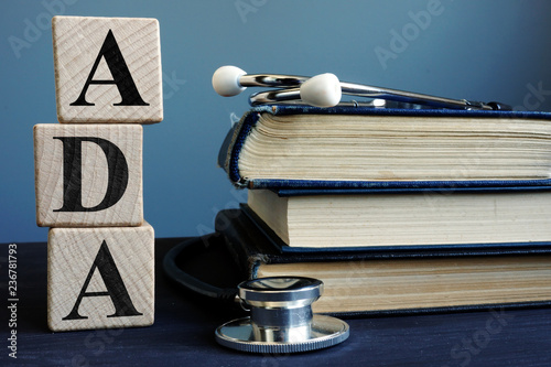 Word ADA Americans with Disabilities Act from cubes and books. Wallpaper Mural