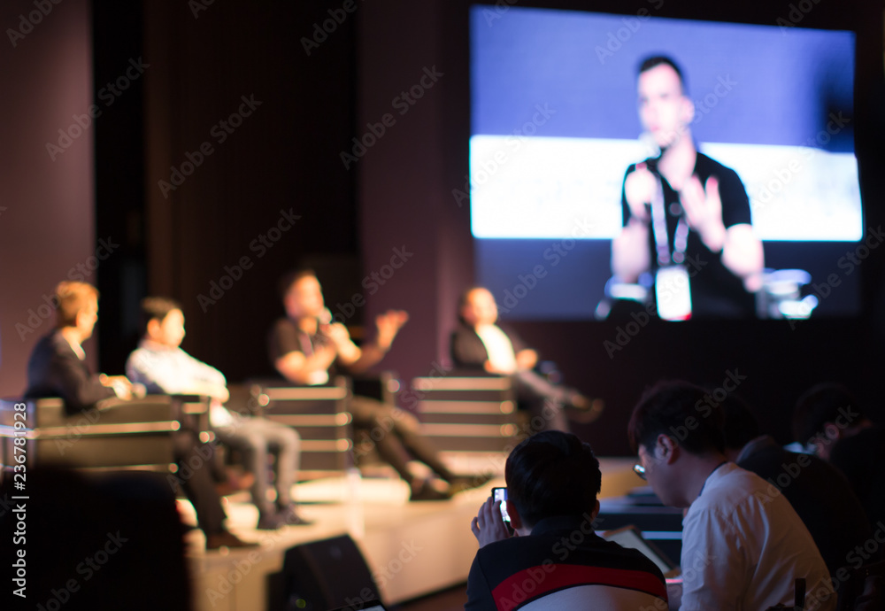 Fototapeta Panel on Stage during Discussion Event. Debate with Experts during Conference Seminar Presentation. Successful Executives and Entrepreneur Speakers and Presenters in Conference Hall Lecture Series.