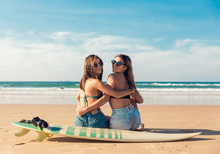 Two Surfer Girls At The Beach