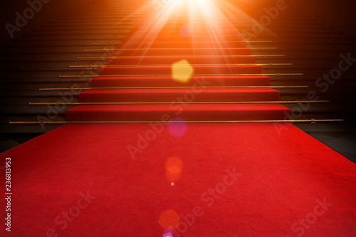 fototapeta na szkło Red carpet on the stairs on a dark background. The path to glory, victory and success