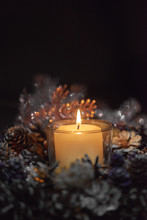 Advent Decoration, Wreath, Candle. In The Dark A Candle In A Beautiful Decorative Wreath Is Burning.