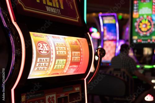 Fotografie, Obraz  Close up of gaming slot machines in casino