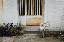 Chair In Abandoned House Yard