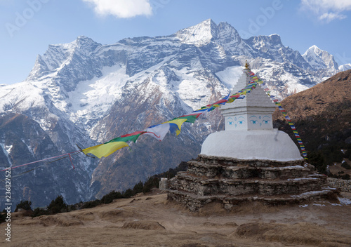 Deurstickers Asia land Buddhist white stupa with prayer flags above Namche Bazaar in Nepal Himalayas