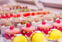 Beautiful Delicious Pastries With Raspberry On A Showcase In A French Shop.