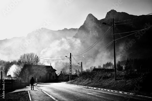 Recess Fitting Gray traffic Beautiful misty landscape in well known Busteni mountain resort with Caraiman mountains in the background, Prahova Valley, Romania. Street photography, black and white creative image.