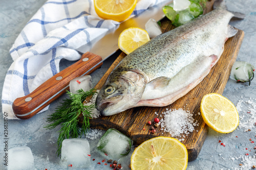 Preparation of trout, sliced lemon and green dill.