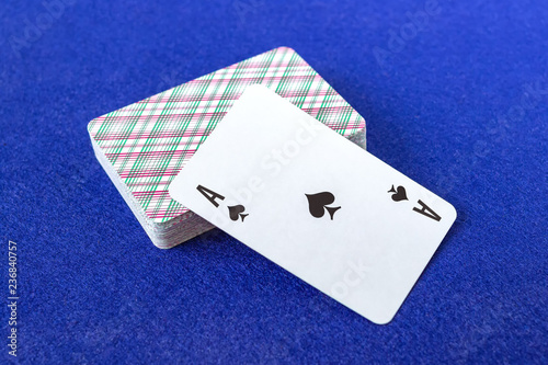 Photo  A deck of cards on blue cloth