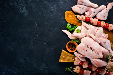Set of chicken meat. On a black stone background. Top view. Free copy space.