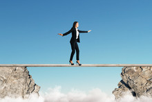 Woman Balancing Between Cliffs