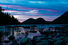 A Landscape View Of Jordan Pond During Sunset In Acadia National Park In Maine.