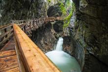 Hiking Along A Woodend Boardwalk In A Canyon Near Kaprun, Austria, Europe