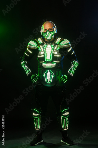 Photo  Mysterious man in black wear, neon mask and gloves
