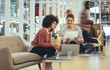 Leinwanddruck Bild - Women entrepreneurs sitting in a lounge at work place