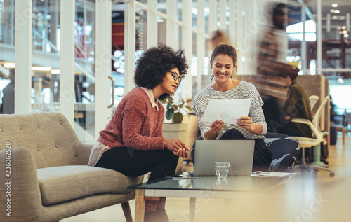 Women entrepreneurs sitting in a lounge at work place