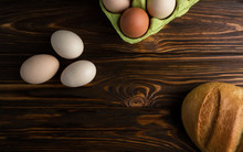 Eggs And Bread On Wooden Table...