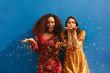canvas print picture - Female friends blowing off magic glitter