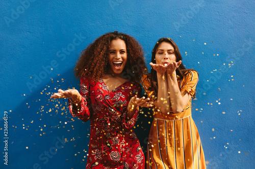 Obraz Female friends blowing off magic glitter - fototapety do salonu
