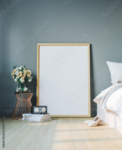 Cozy bedroom with empty poster frame. Frame mockup in interior.
