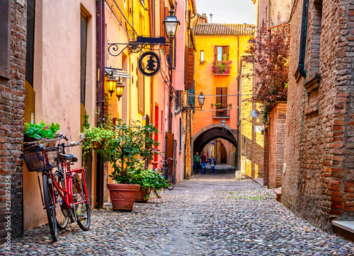 Foto op Plexiglas Oude gebouw Cozy narrow street in Ferrara, Emilia-Romagna, Italy. Ferrara is capital of the Province of Ferrara