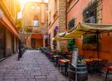 Fototapeta Uliczki - Old narrow street in Bologna, Emilia Romagna, Italy