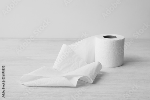 Fotomural Soft toilet paper roll on light background