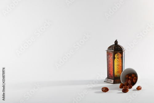 Muslim lamp and dates on white background. Space for text