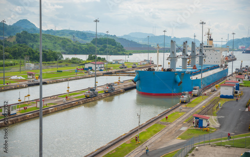 Poster Channel Large cargo ships pass through the Panama Canal locks. This everyday event, provides income from both fees, and tourism, for the whole country.