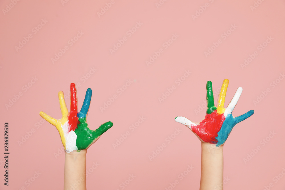 Fototapeta Little child's painted hands on color background