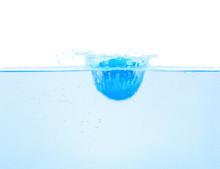 Bath Bomb Splashing Into Water On White Background