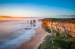Leinwanddruck Bild - The 12 Apostles at sunset, near Port Campbell, Shipwreck Coast, Great Ocean Road, Victoria, Australia.