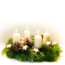 Decorated Advent Wreath From Fir And Evergreen Branches With Burning White Candles For The Time Before Christmas, The Light Background Fades To White, Copy Space