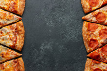 Cut Into Slices Delicious Fresh Pizza Pepperoni And Pizza Four Cheese On A Dark Background. Top View With Copy Space For Text. Pizza On The Black Concrete Table. Flat Lay