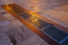 Metal Grille Drainage On Marble Floor Tiles