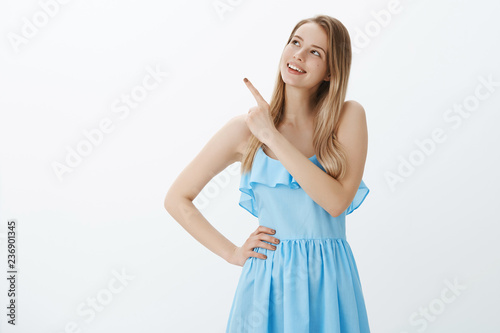 Fotografie, Obraz  Portrait of dreamy good-looking bright young girl with fair hair in blue dress g