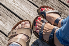 Closeup Of Sandals On Wood Pier