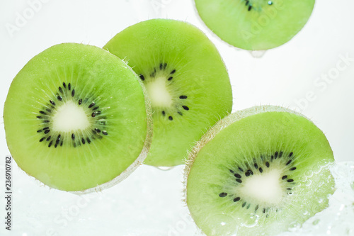 Recess Fitting Splashing water Slices of fresh kiwi in clear water.