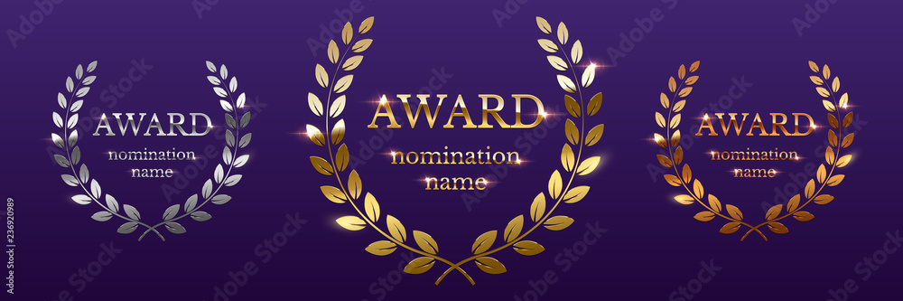 Photo  Golden, silver and bronze award signs with laurel wreath isolated on purple background