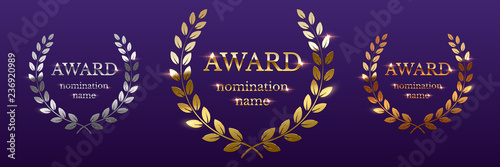 Golden, silver and bronze award signs with laurel wreath isolated on purple background Canvas Print