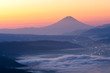 View of Mount Fuji and Sea of mist above Suwa lake in morning from Takabochi Highland, Mountain Takabochi, Nagano prefecture, Japan.
