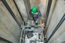 Lift Machinist Repairing Eleva...