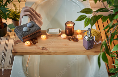 Staande foto Spa Modern spa center and bath room interior concept. Piece of wood for candle towel and soap style, dim light, relax decor.