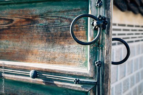 Fotografie, Obraz  Korean traditional wooden door and doorknob