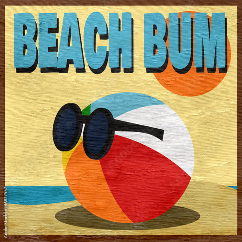 Photo  beach bum design with beach ball on wood grain texture