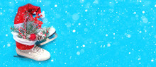 Christmas Skates Ice With Festive Decor. Christmas Toys, Pine Branch, Candy And Cones In The Bouquet. Flat Lay Top View.on Blue Background  Long Banner