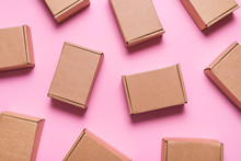 Lot Of Cardboard Boxes On Pink Background