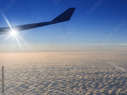 Fotografie, Obraz  airplane flying over clouds.